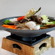 Seafood Gui <br /> Marinated seafood grilled and servered on a hot sizzling pan